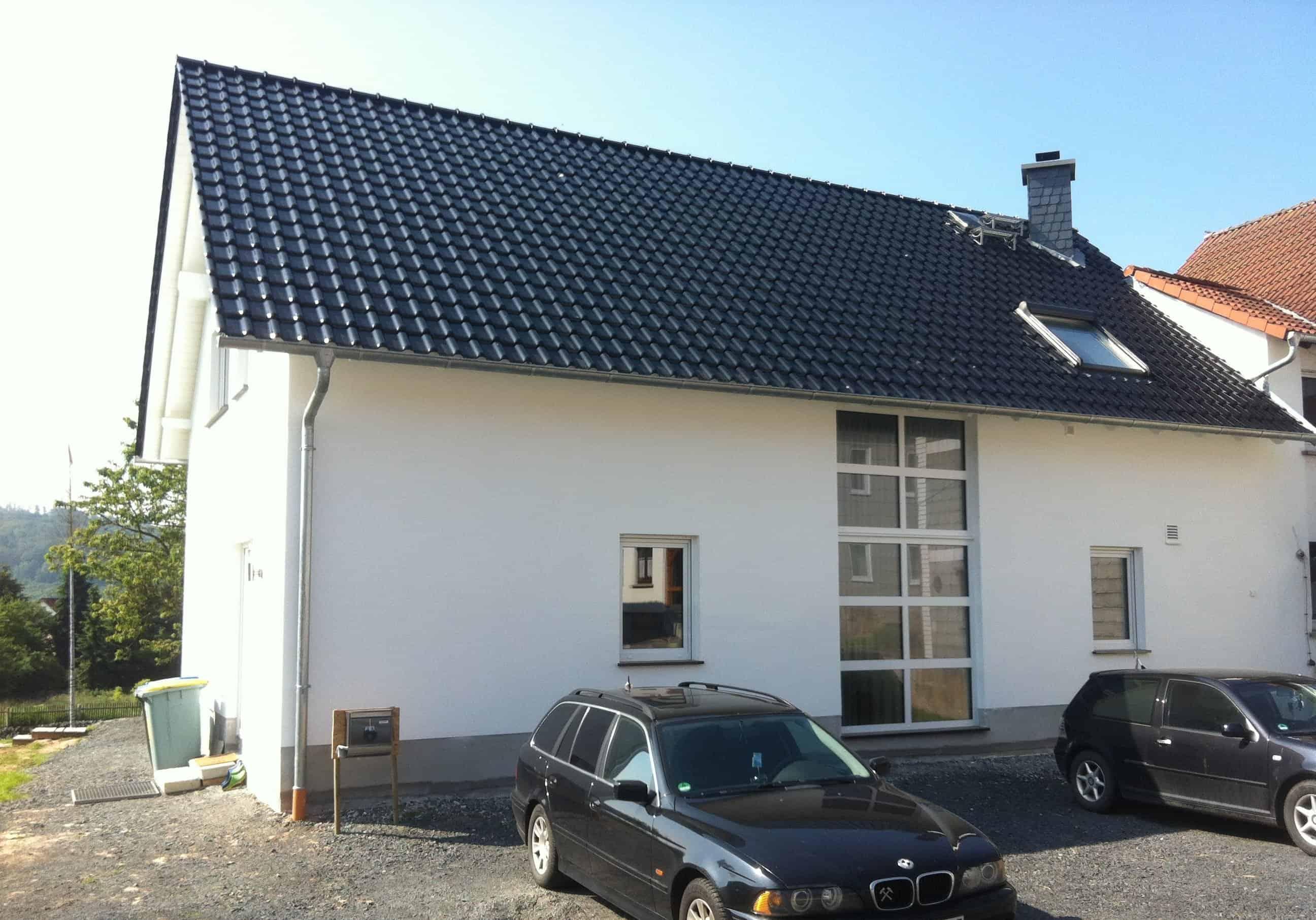 Einfamilienhaus als Anbau an Bestandsgebäude mit Innen-Luftwärmepumpe und Wohnraumlüftung